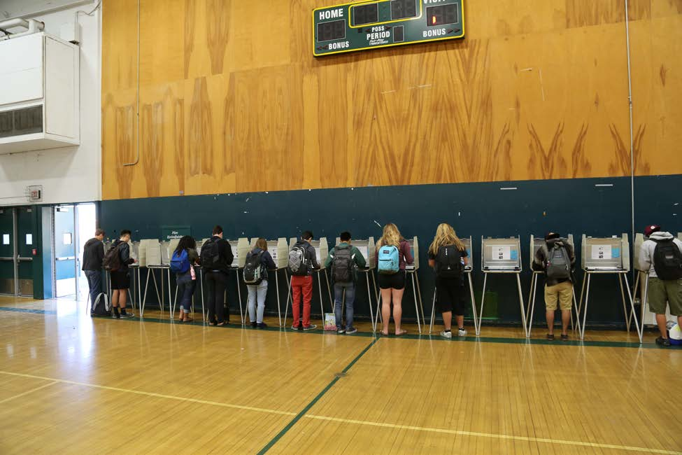 Image of a High School Mock Election where students are mock voting in voting booths at Rio Americano High School in 2016